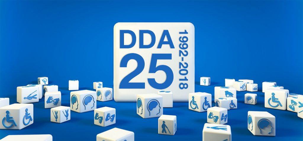 White cubes scattered around an oversize cube against a blue background. Each small cube has a different disability access symbol on it. The large cube has the letters DDA and 25 printed on it in large type. 1992-2018 is arranged vertically next to DDA 25.